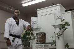 Bishop Orlando McClain, pastor of the House of Refuge Apostolic Church in Ames, stands before the pulpit in the church as he talks about opening a martial arts academy that will operate out of an adjacent building. Photo by Michael Crumb/Ames Tribune  http://amestrib.com/news/ames-and-story-county/black-belt-pastor-returns-his-first-passion