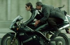 Trinity,Ducati 996 Matrix Welcome To The Future, The Future Is Now, Trinity Matrix, Lana Wachowski, Ducati 996, Color In Film, Matrix Reloaded, Netflix, Carrie Anne Moss