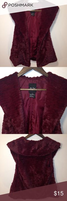 Me Jane Faux Fur Vest Very soft faux fur vest by Me Jane.  Burgundy. Like new condition with no flaws. 100% polyester. Me Jane Jackets & Coats Vests