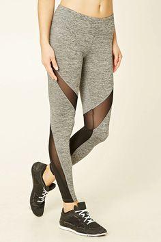 A pair of heathered knit leggings with mesh panels, an elasticized waist, moisture management, and a hidden key pocket.