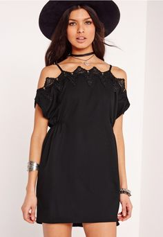 Play up to your sweet side with this totally dreamy black swing dress. Featuring crochet detailing to the trim to create a bardot neckline and with straps to each shoulder, this mini dress will give you boho vibes in no time. Team up with a...