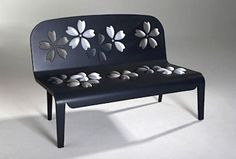 Raised, upholstered flowers on a wooden bench by Alessandra Baldereschi