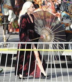 Leggy on set: Lady Gaga showed off her sculpted stems as she filmed a carnival scene for American Horror Story: Hotel in Santa Monica, California on Wednesday