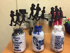 Friend at work made these for me to take to our 2016 Cross Country Banquet - XC Banquet Centerpieces - spray painted sayings that were made into stencils and filled with white fillers, added some school colors on top Cross Country XC centerpieces Sports Banquet Centerpieces, Banquet Decorations, Party Centerpieces, Banquet Ideas, Cross Country Shirts, Cross Country Running, Graduation Party Decor, Grad Parties, Team Dinner