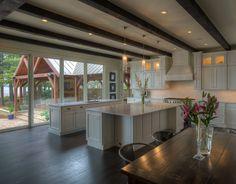 dark wood beams in lake house kitchen