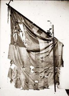 Tattered Civil War Flag showing the effects of battle