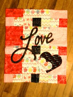 """Featuring Clair's """"LOVE"""" collection wall hangings at Sirens Fare: We carry a wide variety of Clair's Quilted wonder's."""