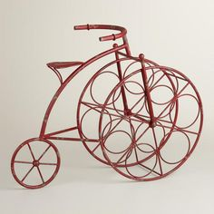 Reminds me of my sister....my long, lost, seester.....Red Bicycle 6-Bottle Wine Rack