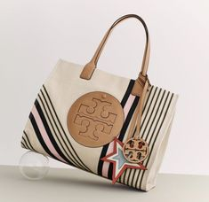327c10fefccae Visit Tory Burch to shop for Ella Printed Canvas Tote and more Womens View  All. Find designer shoes