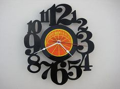Here we have a custom handcrafted vinyl record clock.    Each clock has been hand cut out of a vinyl record, then assembled with a small clock