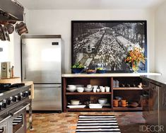 Ellen Pompeo's kitchen: Open shelving, industrial-style stainless-steel appliances.