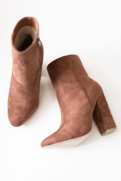 "Tan faux suede high ankle booties with side zipper and 4"" heel. Lightly padded insole. Slightly pointed toe. This style runs small, be sure to order a half size up. - All man made material - Imported"