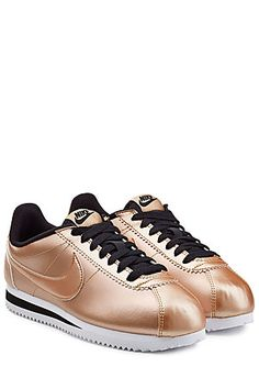 In a glowing shade of metallic rose gold, these leather Nike sneakers are a balance of fashion-forward cool and iconic urban attitude #Stylebop