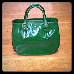 Kate Spade green patent satchel! Gorgeous Beautiful green patent satchel with snap top, gold detailing, fun polka dot lining with zip pocket and two additional pockets inside. Removable 39 inch strap so this bag can be worn a few ways! Dust bag also included! Never worn!12 inches x 9 inches. Nice round bottom shape! kate spade Bags Satchels