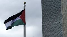 The Palestinian flag was raised at the United Nations headquarters for the first time on Wednesday, as President Mahmoud Abbas urged member states to back a two-state solution and bring an end to Israel's occupation of the territories.