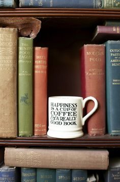 """Happiness is a cup of coffee and a really good book"""