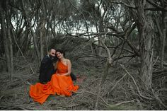 This photo is absolutely amazing with the orange #wedding dress as the focal point!  From http://greenweddingshoes.com/an-orange-wedding-dress-kirsty-matt/  Photo Credit: http://pobkephotography.com/blog/