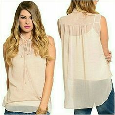 Tank top blouse NWT Pretty blush pink chiffon layered tank top with tiny dark pink polka dots. Criss cross faux wrap design in the front. Sheer pair with a white cami underneath. Available in Small 7/8, Medium 9/10.  Soft flowy polyester. Great quality and design. Brand new with tag. Boutique Tops Tank Tops
