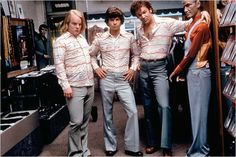 """Scotty (Philip Seymour Hoffman), Dirk (Mark Wahlberg) & Reed (John C. Reilly) try on some new threads in """"Boogie Nights"""""""
