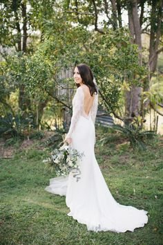 Long Sleeved Lace Wedding Dress // Photography - White Images