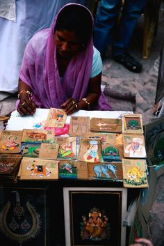 artisan painting post cards. We love this discoveries. Curious who this artisan is. #heartisan #discovered #artisan