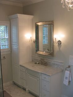 source: West End Cabinet Company      Master bathroom with gray walls paint color, Restoration Hardware Venetian Beaded Mirror flanked by French crystal sconces and white bathroom vanity with marble countertop.