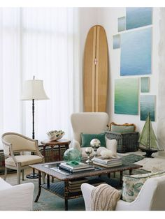 This formal living room is given a casual beach feel using a wooden surfboard and watercolor wall art.