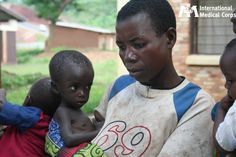 October 3: A mother in Burundi waits in line for treatment for her malnourished child.  Photo: Margaret Aguirre/International Medical Corps, Burundi 2009
