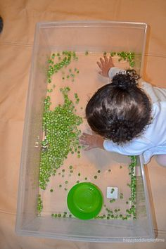 Green peas are not only fun to eat they also make a fun sensory bin filler! Here is a great taste safe sensory bin for babies, toddlers & preschoolers! Baby Sensory Play, Sensory Bins, Tuff Tray, Green Peas, Infant Activities, Toddler Preschool, Kids And Parenting, Nursery, Happy