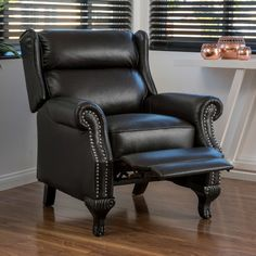 the curtis recliner club chair is a wonderful addition to any room upholstered in beautiful pu leather this recliner sports a classic look while sti