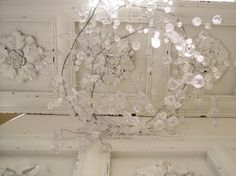 Faux crystal garland from Summers At the Cottage.... entwine with a plain light fixture to make your own crystal chandelier