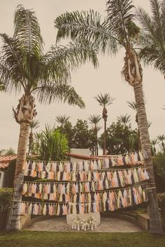 tassels between trees make for the perfect ceremony backdrop.
