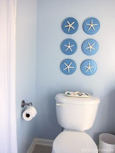 Use round place mats and decorate with star fish or shells....I'll try that. Get a blue or beige round place mat from walmart, target...