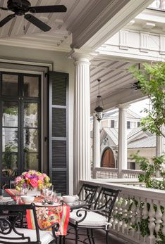 Charleston porch with tall shutters and classical wood trim details