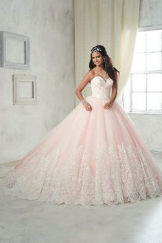 Make a grand entrance in a House of Wu Quinceanera Dress Style Number 26852 during your Sweet 15 party or any formal event. Crested by a sweetheart strapless bodice with lace and minimalist bead work,