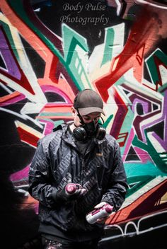 This was the best front on picture of the graffiti artist, as he didn't want any pictures. I like how its a normal action/ a moment in time.