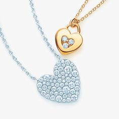 Heart pendants with diamonds. From top: Tiffany Locks pendant in 18k gold and Tiffany Metro in 18k white gold. #TiffanyPinterest