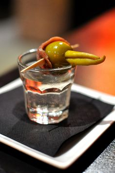Basque white wine served with a gilda (lollipop) made of olive, anchovy and Basque pepper.
