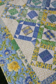 Cotton Candy Quilt - I love blue and yellow, and florals - so this is a win, win win!.