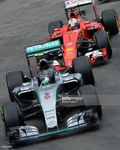 Mercedes AMG Petronas F1 Team's German driver Nico Rosberg (L) and Scuderia Ferrari's German driver Sebastian Vettel drive at the Monaco street circuit in Monte-Carlo on May 24, 2015, during the Monaco Formula One Grand Prix. AFP PHOTO / BORIS HORVAT