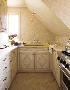 Small Kitchen, for basement I like the layout. Cabinets and tile herringbone floor.