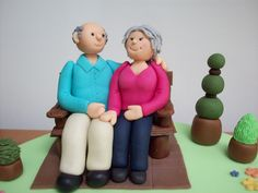 50th wedding anniversary cake topper, sugarpaste figures on garden bench