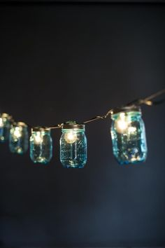 Mason Jar lights from Bourbon and Boots in Little Rock, Ar Blue Mason Jars, Mason Jar Lamp, Jar Lights, String Lights, Light String, Festoon Lights, Glass Lights, Twinkle Lights, Hanging Lights