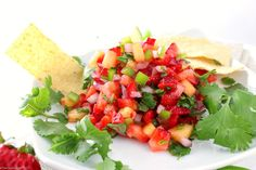 Summer Strawberry Jalapeno and Pineapple Salsa - The Chunky Chef-Fresh, summery, and tasty! This strawberry jalapeno and pineapple salsa is perfect with crisp tortilla chips, or as a topper for some grilled chicken. Taco Dip, Rotel Dip, Pineapple Recipes, Pineapple Salsa, Restaurant Salsa, Beer Cheese Sauce, Sauces, Baked Beans With Bacon, Jalapeno Salsa