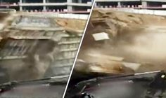 THIS is the terrifying moment construction workers were forced to run for their lives as a massive wall collapsed.