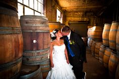 Redsphere Studios- Bride and groom kissing at their wedding at the Old Sugar Mill Winery in Sacramento, CA