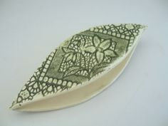 Ceramic Tatting Shuttle with lace imprint.    Sigh, some day...