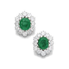 Pair of emerald and diamond ear clips, Bulgari Each of cluster design, set with a cushion-shaped emerald weighing 14.58 and 15.38 carats, highlighted with brilliant-cut diamonds, signed Bulgari.