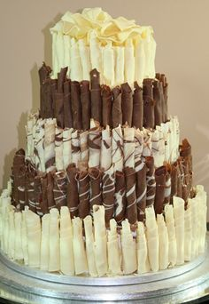 Rossone chocolate cake - 20 amazing alternative wedding cake ideas - There's more chocolate in this Zucchero Patisserie Rossone cake than you can shake a stick at. If you want something slightly breath-taking and are a serious chocoholic, then a Rossone-style cake is the perfect option...