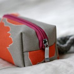 Create your own mini cosmetic bag in your favorite prints! ~ Always useful to have another version of this tutorial